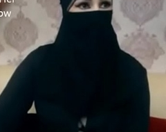 Indian Muslim girl in hijab conform to conversing on webcam